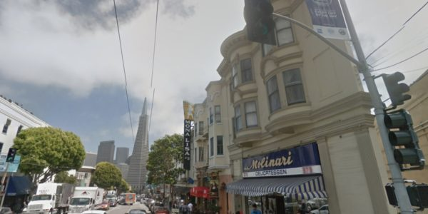 Street view of 371 Columbus cohousing Residences located in North Beach with Transamerica Pyramid in the background.