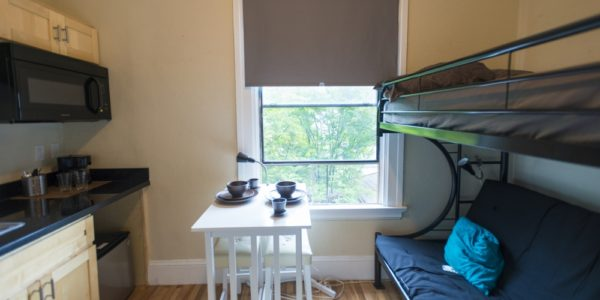 Cozy single bedroom with dining set and kitchenette. Urbanests coliving provides fully furnished rooms for your convenience.