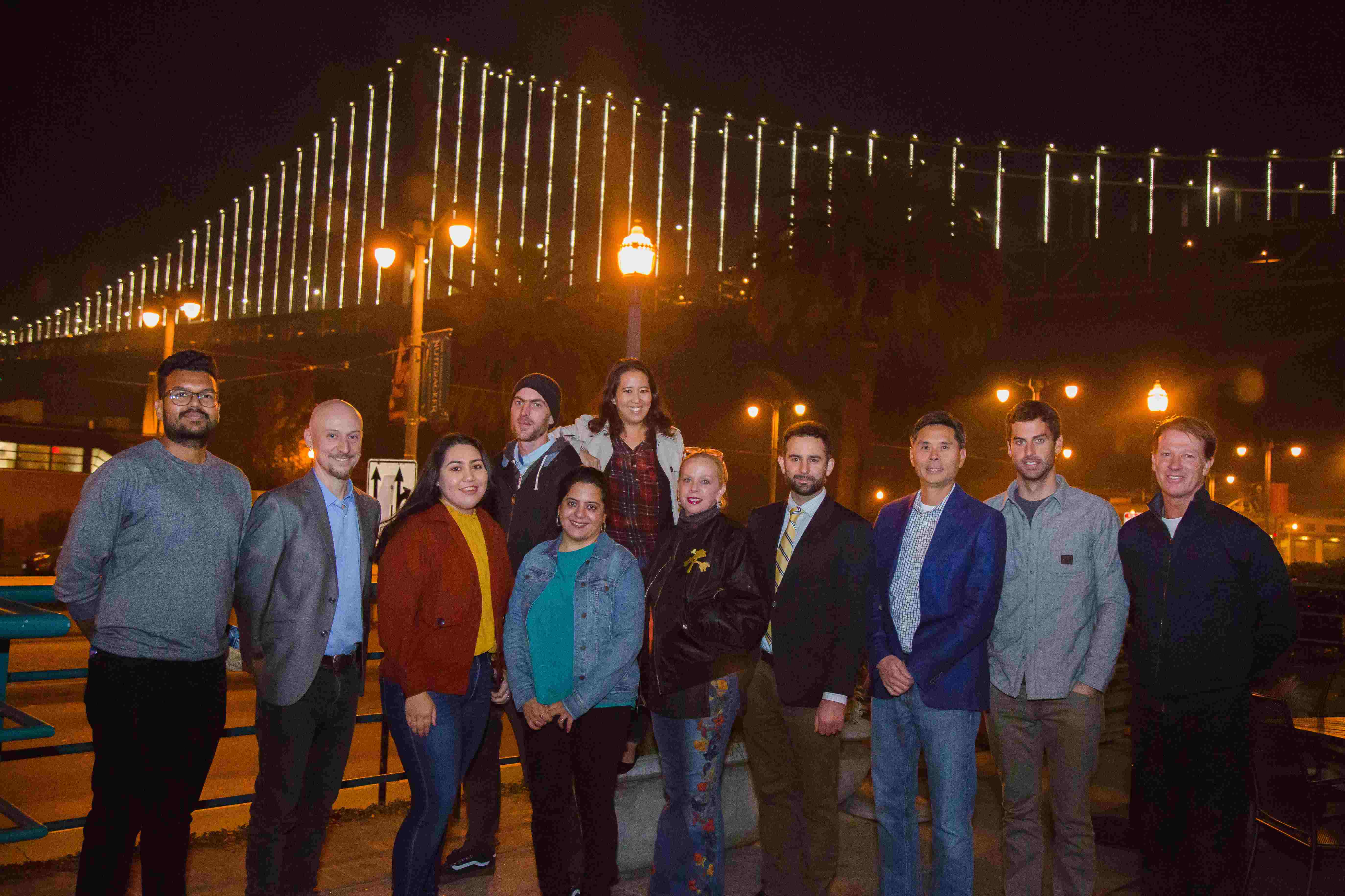 Group photo of Urbanests team in front of Bay Bridge in San Francisco.