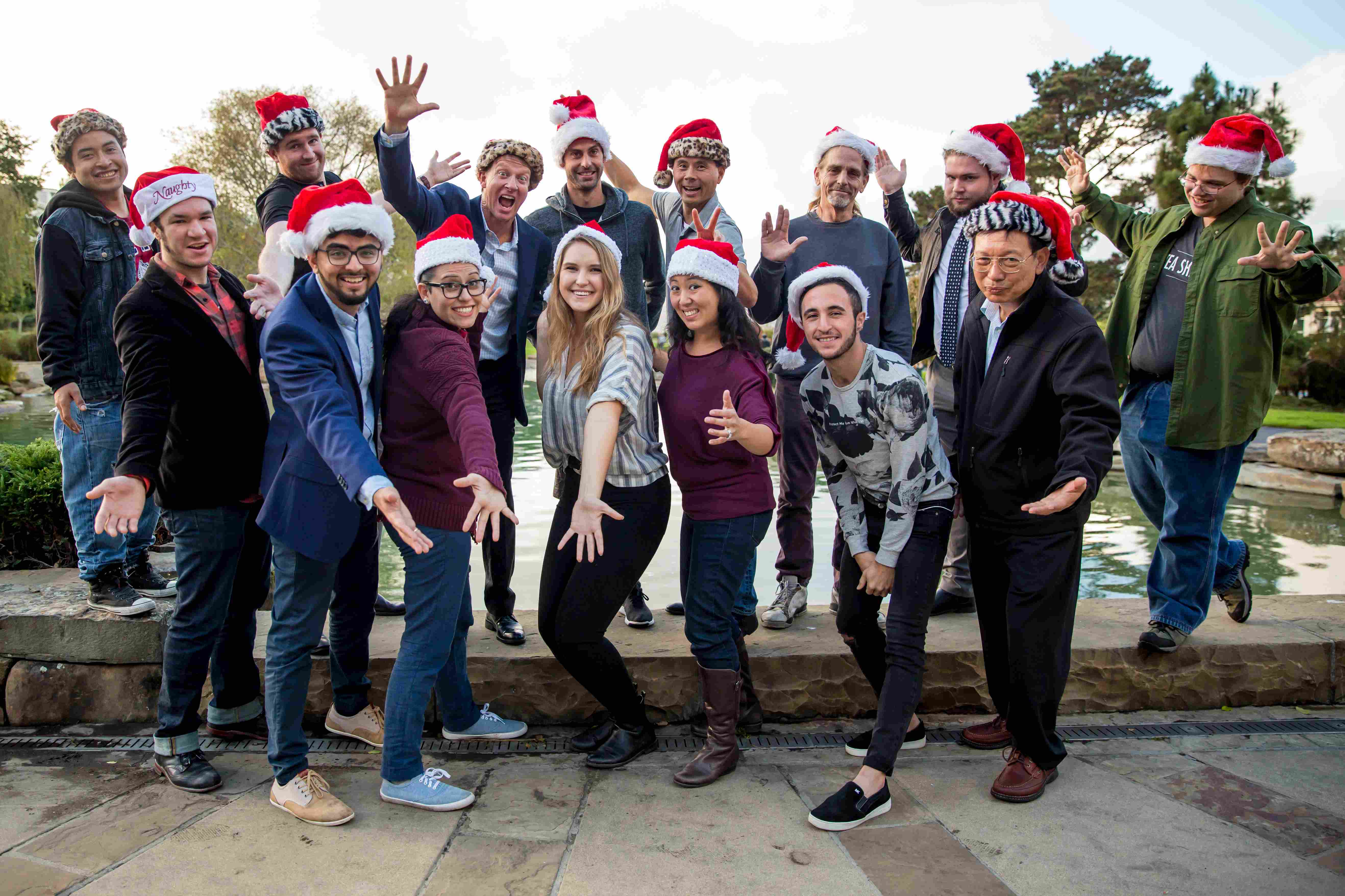 Group photo of Urbanests team wearing holiday hats.