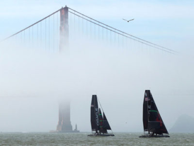 A pair of AC 45 from defending America's Cup champion Oracle Racing sails near the South Tower of the Golden Gate Bridge in San Francisco Bay, California February 21, 2012. San Francisco will host the America's Cup in 2013.  REUTERS/Robert Galbraith  (UNITED STATES - Tags: SPORT YACHTING TPX IMAGES OF THE DAY)