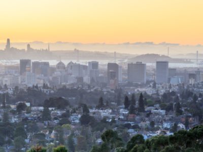 Sunset over Oakland and San Francisco Hazy Skylines. Oakland Hills, Alameda County, California, USA.