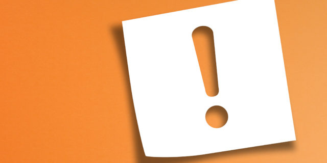 Note paper with exclamation mark on panoramic orange background