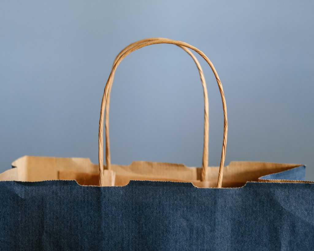 Brown shopping bag made out of paper